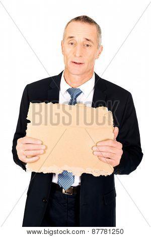 Mature businessman with a piece of cardboard