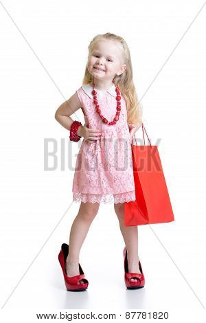 Little Girl Trying Her Mom's Red Accessories And Shoes On