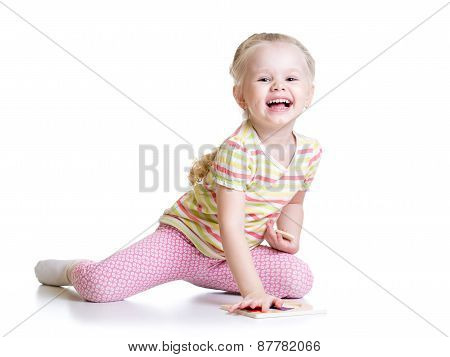 Smiling Kid Girl Solving Puzzle