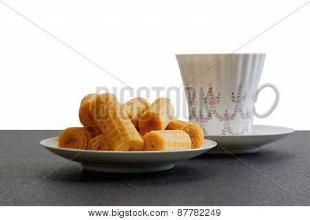 Waffer Rolls And Cup Of China Tea