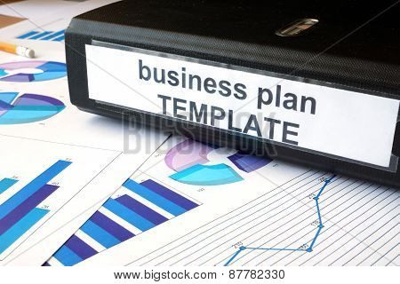 Graphs and file folder with label Business plan template.