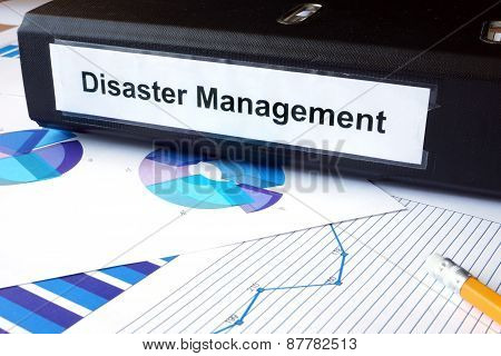 Graphs and file folder with label  Disaster Management.