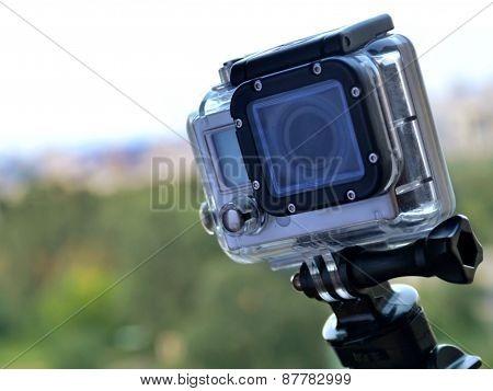 KYIV, UKRAINE - AUGUST 6, 2014: Hand holding small GoPro hero3 camera often used in extreme video