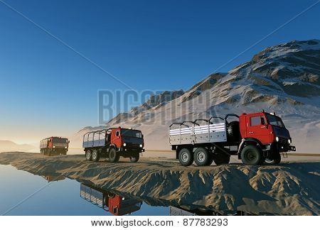 Group of trucks on the road in the mountains.