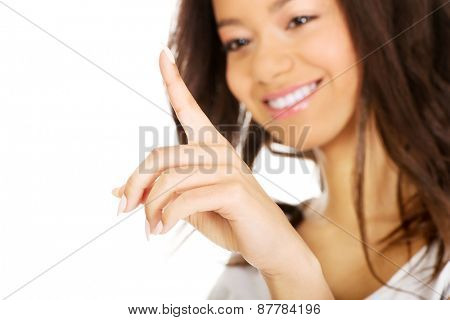 Young african woman touching abstract screen.