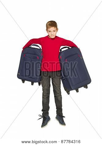 Happy Boy Jumping Holding Travel Bags