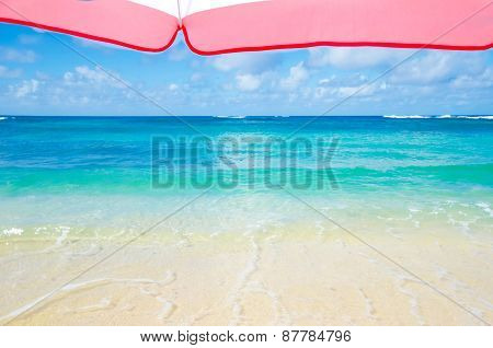 Beach Umbrella Next To Ocean Background