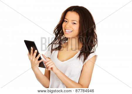 African woman holding tablet computer.