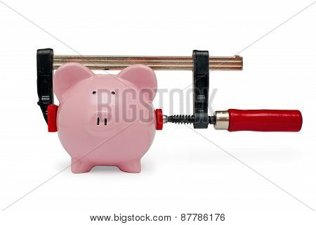 Clamp Holding A Piggy Bank On White Background
