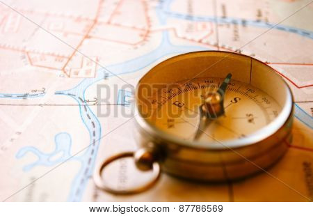 Vintage Compass For Direction Lying On A Map