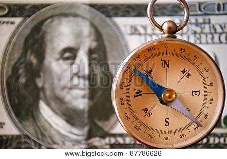 Vintage Compass Standing In Front Of 100 Usd Bill