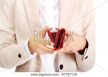 Hands of businesswoman with empty wallet.