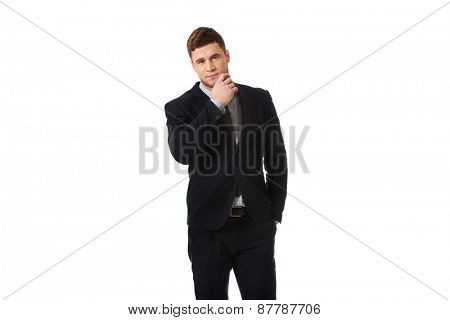 Successful thoughtful businessman with finger under chin.