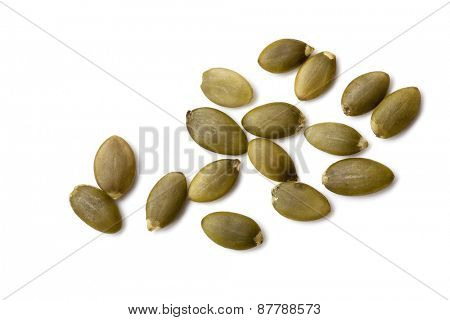 Pumpkin seeds or pepitas, isolated on white background.  Overhead view.