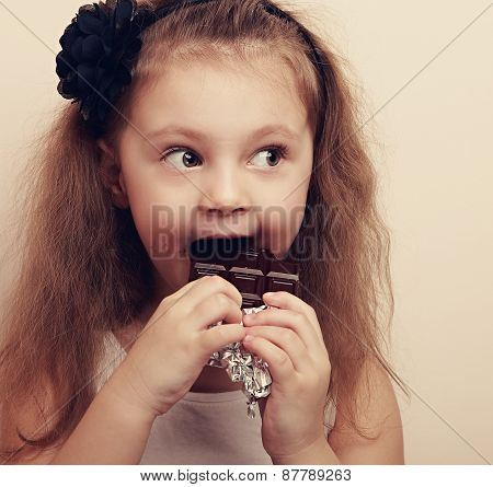 Happy Surprising Kid Girl Eating Chocolate And Looking. Vintage Closeup