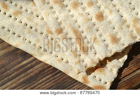 Traditional jewish bread matzo on wooden table
