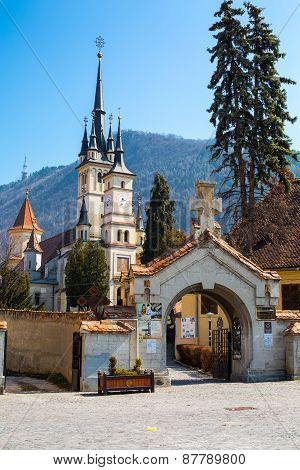 Entrance gate and Saint Nicholas Church in Brasov , Transilvania