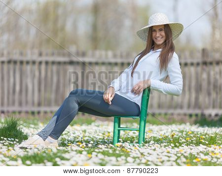 Young Teenage Girl In A Natural Idyllic Setting