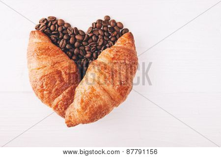 Heart made with croissant and coffee