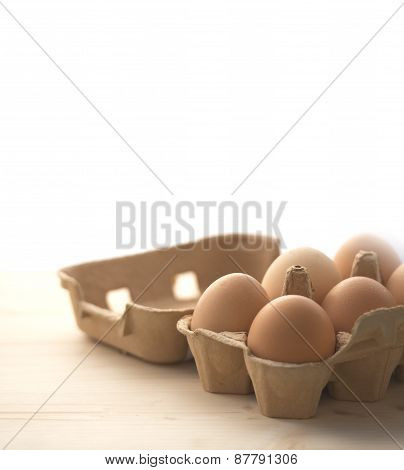 Eggs Over Wodden And White Background