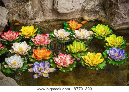 Colorful Artificial Lotus In The In The Pond Of The Wishing Well In Thailand