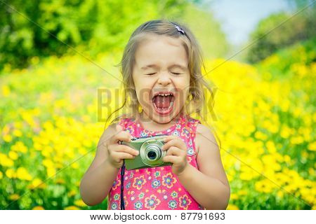 Little girl amazed by pictures on point and shoot camera