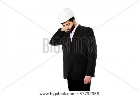 Businessman engineer suffering from neck pain.