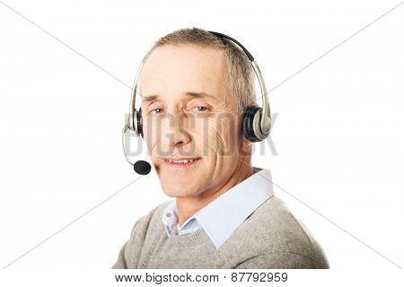 Call center mature man wearing a headset.