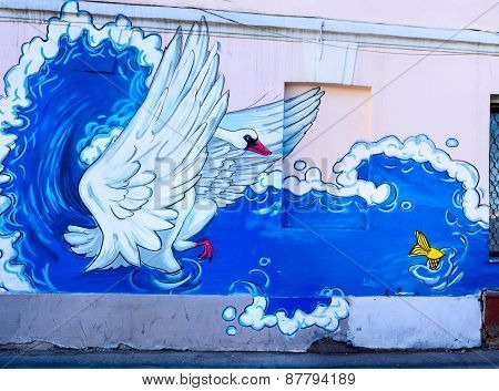 Moscow, Russia - April 11, 2015: Swan And A Fish - Graffiti On The Wall Made By Unknown Artist In Ch