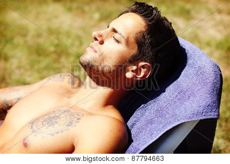 handsome man getting a tan