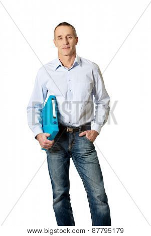 Handsome mature man holding blue binder.