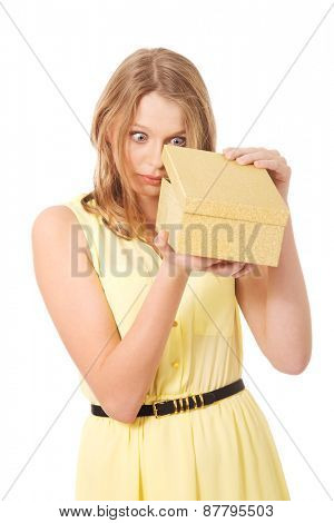 Teenage woman opening gift box
