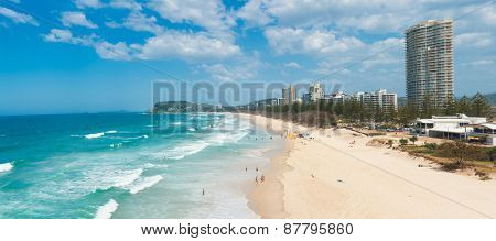 Gold Coast with a beach full of tourists seen from above. Queensland, Australia. Panoramic photo