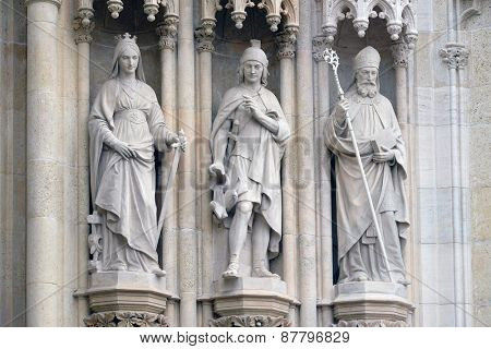 ZAGREB, CROATIA - APRIL 04, 2015: Statue of Saints Catherine, Florian and Cyril  on the portal of the cathedral dedicated to the Assumption of Mary and to kings Saint Stephen and Saint Ladislaus