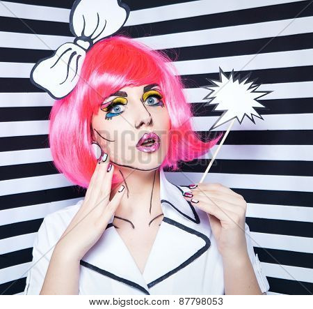 Photo of surprised young woman with talk bubble and professional comic pop art make up and accessories