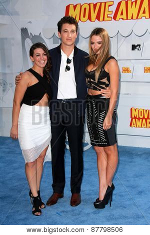 LOS ANGELES - FEB 11:  Guest, Miles Teller, Keleigh Sperry at the MTV Movie Awards 2015 at the Nokia Theater on April 11, 2015 in Los Angeles, CA