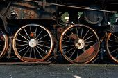 stock photo of train-wheel  - Wheels of an old train closeup photo - JPG
