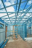 stock photo of framing a building  - industrial building currently under construction using steel frames - JPG