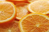 stock photo of valencia-orange  - background made of few sliced juicy oranges - JPG