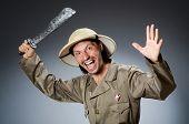 stock photo of hunter  - Funny safari hunter against background - JPG