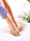 picture of wet feet  - groomed female feet on a white towel during a spa treatment - JPG