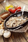 pic of porridge  - Buckwheat porridge with champignons in a metal pot on the table