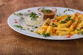 foto of high calorie foods  - French fries on a plate with different spices - JPG