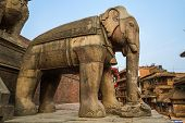 picture of three tier  - A stone elephant at a temple in Bhaktapur - JPG