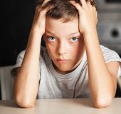 foto of abused  - Sad boy at home - JPG