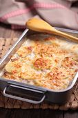 image of baked potato  - Potatoes a la dauphinoise in a baking dish - JPG