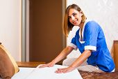 image of maids  - Happy maid making bed in hotel room - JPG