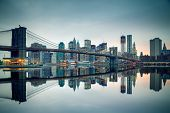 stock photo of bridges  - Brooklyn bridge and Manhattan at dusk - JPG