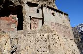 picture of armenia  - Cells of Geghard rock monastery with ancient khachkars  - JPG