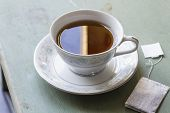 stock photo of black tea  - British black tea in a dainty tea cup and saucer - JPG